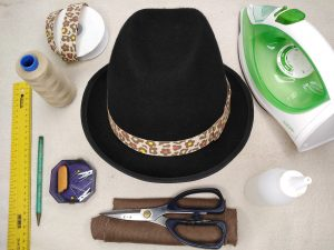 Attach a hatband and bow to a hat